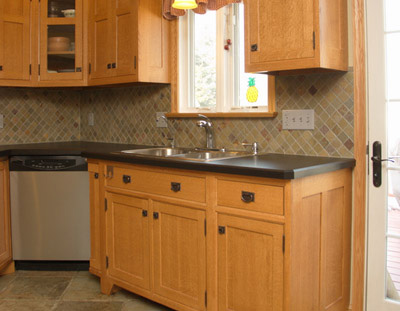 slate mosaic wall tile backsplash, arts and crafts custom cabinets, oak cabinets, stainless steel oven and microwave