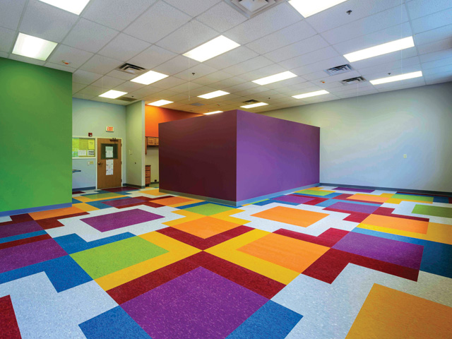 childcare classroom, multicolored VCT (vinyl composition tile) flooring, painted walls, partial wall room divider