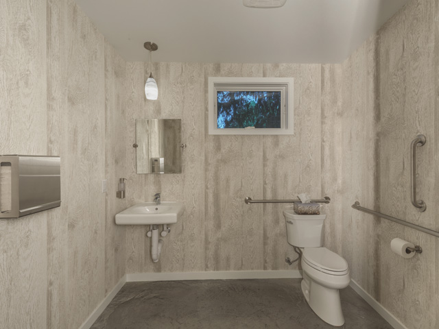showroom restroom, woodgrain vinyl wallpaper, white bathroom