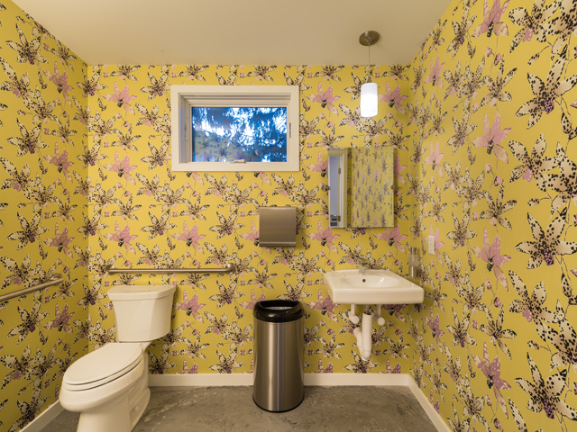 showroom restroom, vibrant floral wallpaper