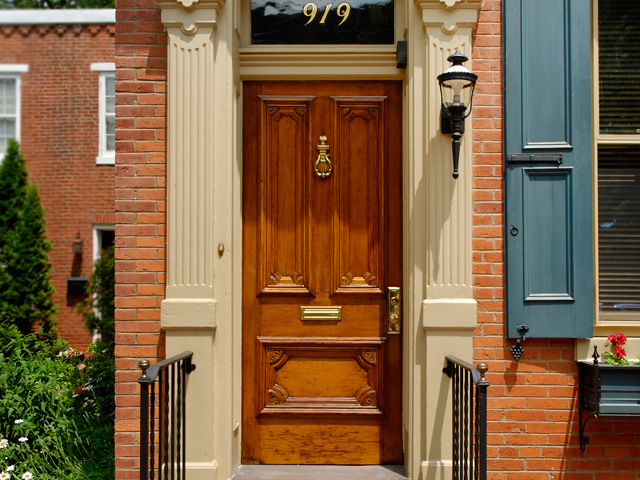 historic door restoration with clear finish, brass hardware