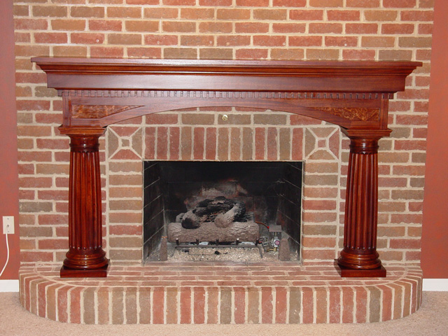 custom mahogany mantel with fluted columns, dental moulding, curly maple inset