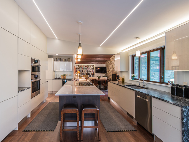 A complete, mid-centry modern house renovation, including the living area, kitchen, two bathrooms, bedroom, coatroom, and laundry.